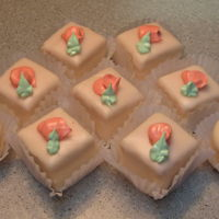 Petit Fours Pastel petit fours with poured fondant. & piped royal icing rose buds