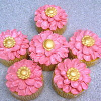 Pink Flower Cupcakes piped flowers with Swiss Meringue buttercream, fondant buttons painted gold.