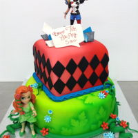 Poison Ivy And Harley Quinn Cake 2 tiers birthday cake featuring plastic figurines of Poison Ivy and Harley Quinn, airbrushed white Satin Ice fondant
