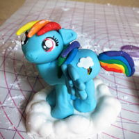 Rainbow Dash Gum paste rainbow dash. I used a toothpick in each leg then stuck into the Cloud then into foam. When firm I trimmed the bottom of the...