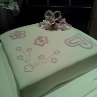 Random Cake Fondant covered cake with some gumpaste flowers, some brush embroidery practise.