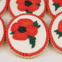 Red Poppy Cookies brush embroidery in red royal icing on roll out sugar cookies