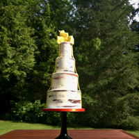 Semi Naked Birthday Cake Simple barely frosted cake, wrapped in a yellow fondant ribbon