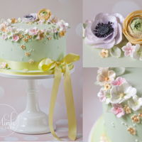 Springtime Cake Tender mint green cake crowned with delicate blossoms