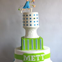 Tennis Player Tiered cake for a tennis tournament. Tennis player is hand made from fondant.