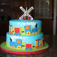 Trains, Trains, Trains This little cake was copied from a pic the mother gave me. Her son was turning 2 years old and loves trains. Buttercream with fondant...