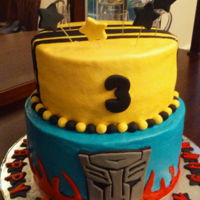 "Transformer Cake 10"" and 8"" cakes. Top is chocolate, bottom vanilla."