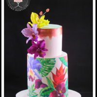 Tropical Birthday Two tier cake decorated with sugar sheets and sugar orchids