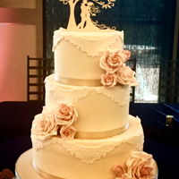 Wedding Cake 3 tier wedding cake covered in ivory fondant w/ lace appliqué and fondant roses