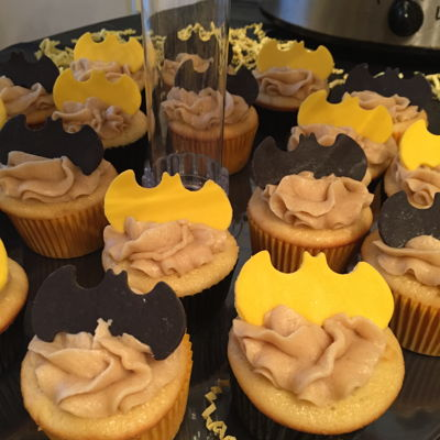 Batman Baby Shower Cupcakes Chocolate chip cookie dough cupcakes with cookie dough frosting. Candy clay Batman toppers. Batman themed baby shower.