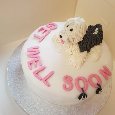Old English Sheepdog Chocolate Cake This is my first ever cake and I know I've got a long way to go to get better but I'm proud of it. It was milk chocolate with...
