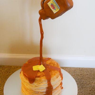 Stack Of Pancakes This is a vanilla cake covered in fondant with a bottle of syrup made out of modeling chocolate.