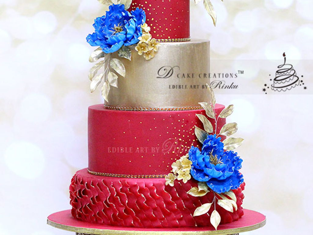 Red & Gold Wedding Cake With Royal Blue Flowers - CakeCentral.com