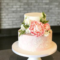 2 Tier Cake With Brush Embroidery And Sugar Flowers :) A small two tier cake with light pink bottom and brush embroidery. Flowers include candy stripe peony and lisianthus with buds and leaves...