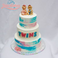 Baby Shower Cake For Twins All 3 tiers arse iced in buttercream. Water color effect. Figures and decorations are MMF.