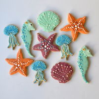 Beach-Themed Cookies Seashells, starfish, jellyfish and seahorses! for a girl's beachy birthday party.