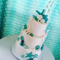 "Beach Themed Wedding Cake Hand made shells, starfish, flowers and ""sea grass"""