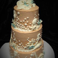 Beach Wedding Small 3 tier buttercream frosted vanilla cake with raspberry filling