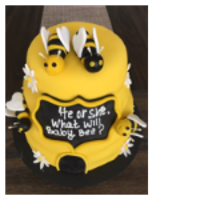 Bee Hive Baby Showwer Cake chocolate cake , and carved to shape of bee hive