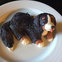 Bernese Mountain Dog Rice Krispie treats formed into dog and covered in marshmallow fondant.