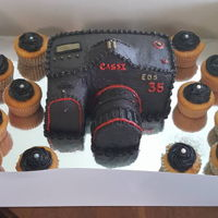 Camera Cake: Buttercream All Buttercream, doweled the lens and also the Camera layers for traveling. Candy Melts for buttons, lens and screen.