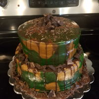 Camo Cake With Chocolate Ganache I made this tiered camo cake for a veterans 90th birthday. I frosted it with a coconut flavored buttercream and filled the layers with that...