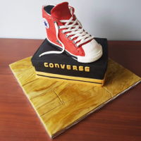 Converse Shoe And Box Red converse shoe cake with shoe box. Chocolate sponge with Nutella buttercream.