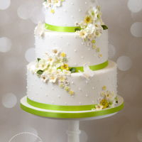Dreaming Of Spring Wedding Cake Delicate spring blossom and butterflies for a wedding