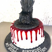 Game Of Thrones Cake Game of Thrones themed cake featuring an Iron Throne cake topper