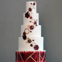 Geometric Wedding Cake Burgundy and red watercolor flecked with blue and green, gold framework and octagons all came together for this modern beauty!