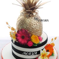 Gold Pineapple Gold pineapple on a colorful cake!