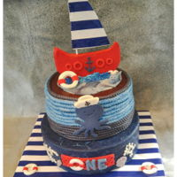 Lennon's 1St Birthday Cake Made yet another nautical themed cake. This was my daughter's request for my grandsons 1st birthday. Also first time making a smash...