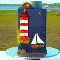 Lighthouse Groom's Cake Lighthouse cake for a groom who loves to sail, with a lighthouse reminiscent of my home town in New England. TFL!!