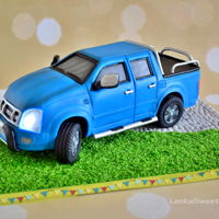 Lighting Car Cake. Lighting Isuzu 3.0 TD car cake with chocolate and vanilla filling and lights from sugar.