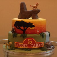 Lion Guard Cake Chocolate lion guard themed cake with painted sunset layer, RKT rock.