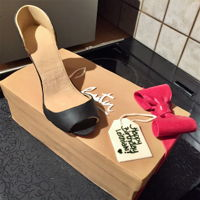 Louboutin Shoe Cake Peep-toe pump sitting on a Louboutin box