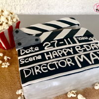 Movie Star Cake Movie themed cake in the shape of a clapper & pop corn