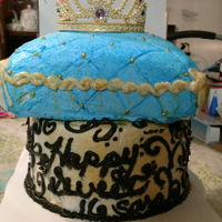 My First Tiered Cake. Crown With Pillow White almond cake and chocolate cake with buttercream frosting. The pillow is carved. First time I ever tiered a cake. First time I ever...