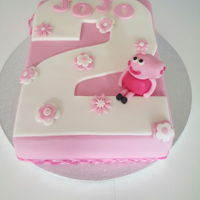 Peppa Pig - 2Nd Birthday My friend wanted a number two cake but I advised it wouldn't feed the amount of people she wanted it for so we went for this design.