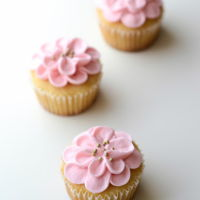 Pink Flower Cupcakes pink flower cupcakes for baby's first birthday - vanilla cupcakes with cream cheese frosting