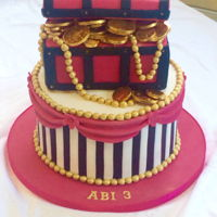 Princess Pirate Cake Chocolate cake with stripes, swags, beads and treasure chest