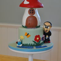 Smurf Cake 2 tiered cake with the top tier in the shape of a smurf mushroom house. I sculpted Gargamel's head and a smurf figurine from...