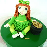 St. Patrick's Day Irish Girl Topper I made this topper for a small St. Patrick's Day cake, and I think she is so cute! She is gum paste with fondant dress and hair. TFL...