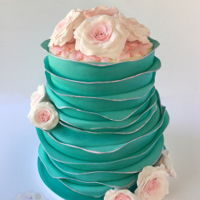 Tiffany Bridal Gumpaste roses, bas relief top, fondant ruffles.. thanks for looking!!
