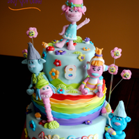 Trolls!! It's a three tier (6, 8 & 10) covered in fondant with fondant accents. The Trolls are handmade from fondant. Thanks for looking!