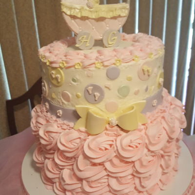 Baby Girl Shower Buttercream with fondant decorations. Vanilla cake with strawberry pineapple filling.