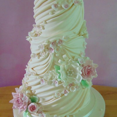Flowers, Pearls And Drapes Wedding Cake