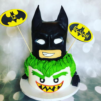 Lego Batman Made this for my son's birthday the top tier is chocolate cake carved into the shape of lego batman and the bottom tier is modeled...