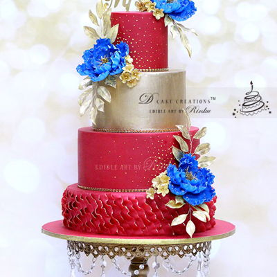 Red & Gold Wedding Cake With Royal Blue Flowers