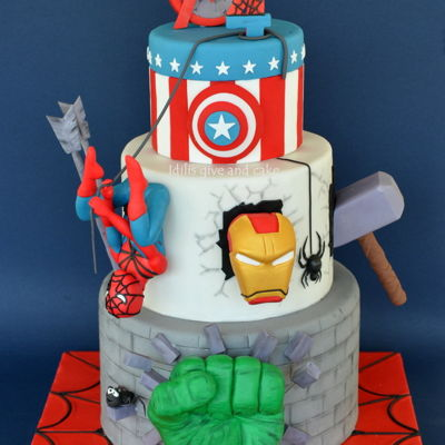 Superheroes Cake For a sweet little boy, our superheroe who had his arm broken but still had a great time at his party !